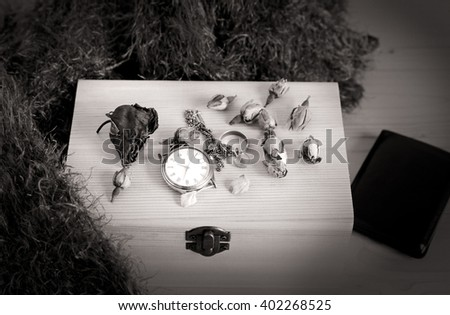 still life with watch on a wooden box - black and white - stock photo