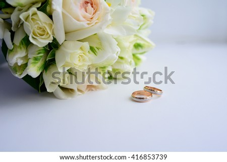 still life with wedding bouquet and wedding rings - stock photo