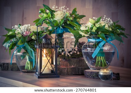 Still life with wedding bouquets and candles, vintage stylized. - stock photo