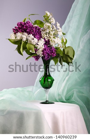 Still life with white and purple lilac in vase - stock photo