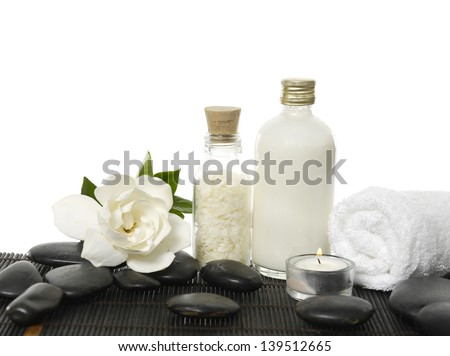 Still life with white gardenia flowers ,candle, towel ,salt in glass, towel on black pebble