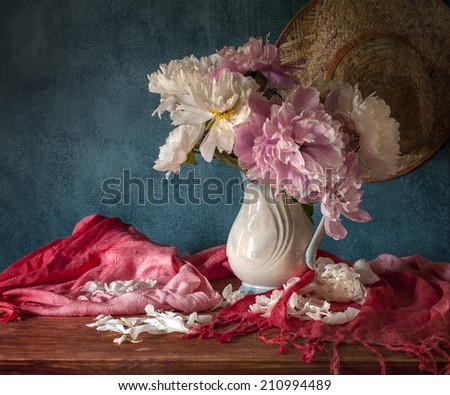 Still life with white peonies in vase - stock photo