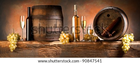 still life with white wine - stock photo