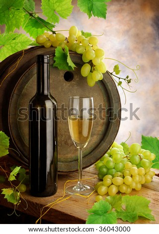 Still life with white wine and cask - stock photo