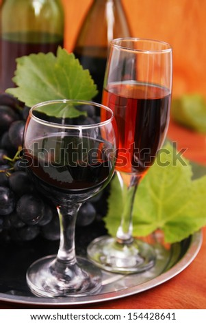 still life with wine bottle, wine glass and grapes - stock photo