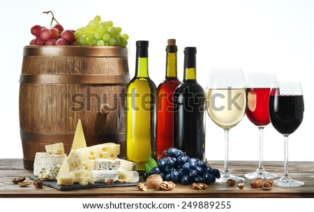 Still-life with wine, cheeses and fruits on white background. - stock photo