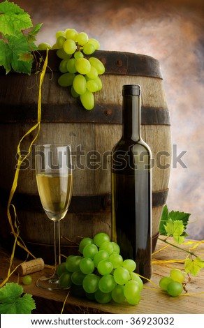 Still life with wine, grapevine and old barrel