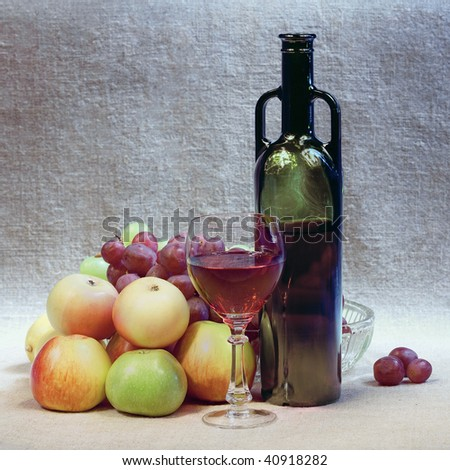 Still-life with wine in a bottle and fruits - stock photo
