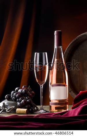 still life with wine in bottle and glass - stock photo