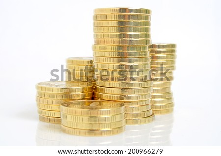 Still life with yellow coins on a white background. - stock photo