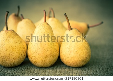 still life with yellow pears - stock photo