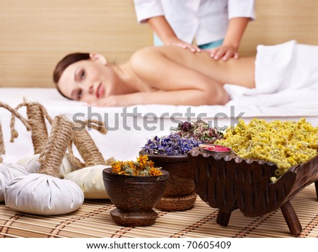 Still life with young beautiful woman on massage table in beauty spa. - stock photo