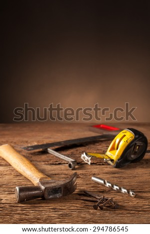 Still life Work tools on a wooden table - stock photo
