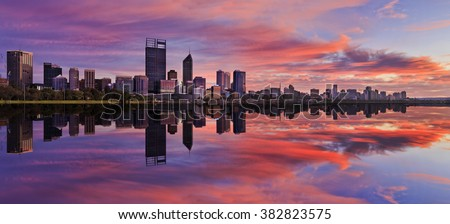 still reflection of Perth Western Australian capital at sunrise in calm waters of Swan River. Horizontal panorama with pink clouds and blue sky