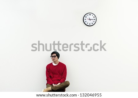 Still waiting for something - man checking time - stock photo