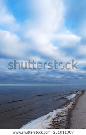Still winter day at gulf of Riga, Baltic sea. - stock photo