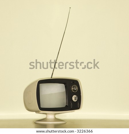 Stilll life of vintage television set with antenna raised. - stock photo