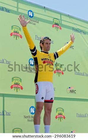 STILLWATER, MN/USA â?? JUNE 21, 2015: Cyclist Laszlo Alberti wins Amateur Omnium yellow jersey as overall race leader at prestigious 2015 North Star Grand Prix in Stillwater. - stock photo