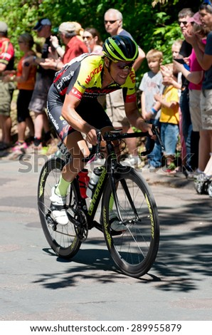 STILLWATER, MN/USA - JUNE 21, 2015: Cyclist Sergio Hernandez charges up Chilkoot Hill at Stillwater Criterium or stage six of prestigious 2015 North Star Grand Prix pro cycling event in Stillwater.  - stock photo