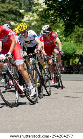STILLWATER, MN/USA - JUNE 21, 2015: Pro cyclist Neal Shepherd (center) of team Colorado Collective in peloton at stage six of prestigious 2015 North Star Grand Prix pro cycling event in Stillwater. - stock photo