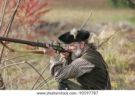STILLWATER,NY, USA - NOV 6: A British loyalist fires his weapon at the annual Battle of Saratoga Reenactment on November 6, 2010 in Stillwater, NY, USA - stock photo