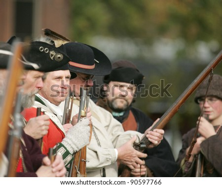 STILLWATER,NY, USA - NOV 6: Revolutionary war soldiers prepare for battle at the annual Battle of Saratoga Reenactment on November 6, 2010 in Stillwater, NY, USA - stock photo
