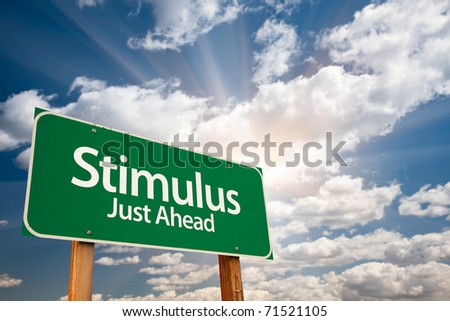 Stimulus Green Road Sign with Dramatic Clouds, Sun Rays and Sky. - stock photo