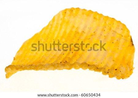 stipped and spiced golden chip on white background - stock photo