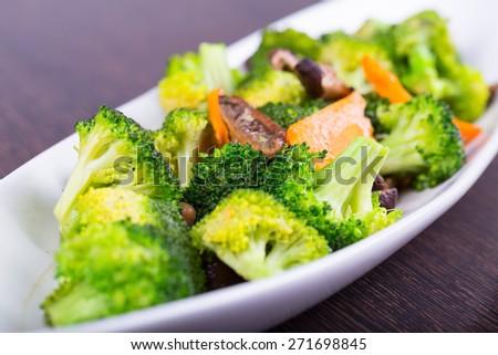 Stir-Fried Broccoli Broccoli white dish. - stock photo
