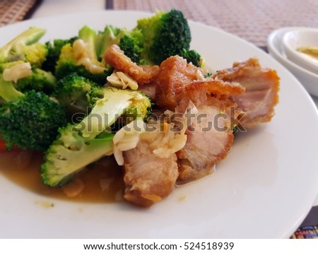 Stir fried broccoli with crispy pork