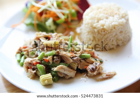 Stir fried chicken and basil served with rice