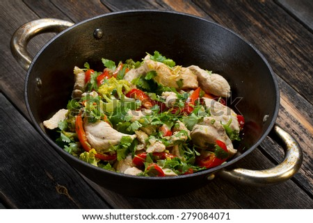 Stir fried chicken breast with broccoli, bell pepper, garlic and coriander - stock photo