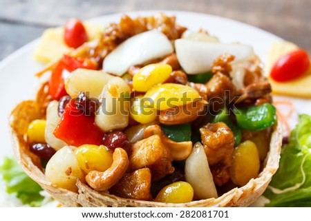 stir fried chicken with cashew nuts, a famous thai food. - stock photo