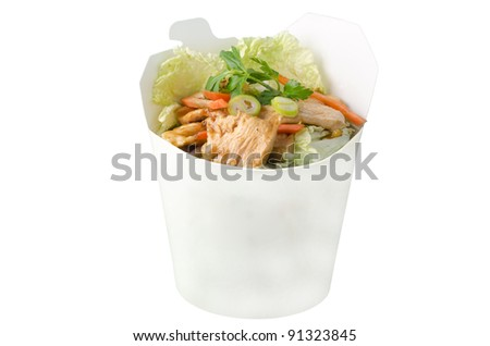 Stir-fried chicken with garlic in takeaway box.