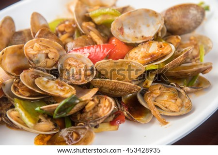 Stir fried clams with roasted chili paste,Thailand food - stock photo