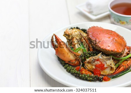 stir-fried crab with green kampot pepper, cambodian cuisine