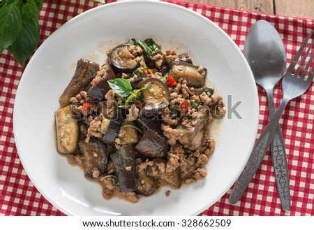 Stir fried eggplant with minced pork and basil, Top view. - stock photo