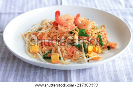 Stir Fried Glass Noodle or Noodles vermicelli with Fresh Shrimp prawn and Tofu in Thai Style, Traditional Thai Food or Food Street in Thailand