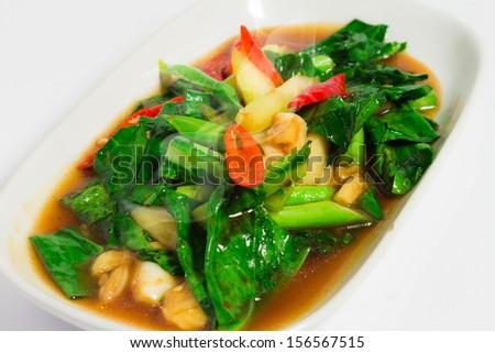 Stir-fried kale with crispy Garlic, hot smoke. - stock photo