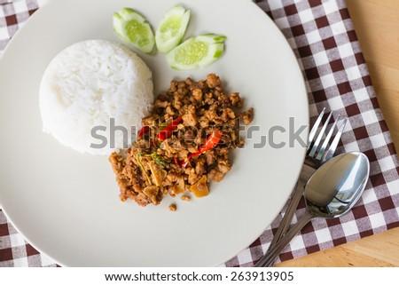 stir fried minced pork with basil and rice - stock photo