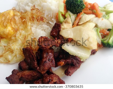 Stir-fried mixed vegetables and Fried sliced pork and Fried egg & Thai jasmine rice