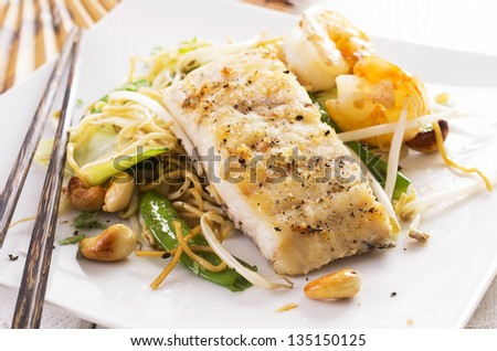stir-fried noodles with vegetable and fish - stock photo