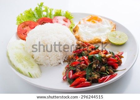 stir-fried pork and basil with rice and egg - stock photo
