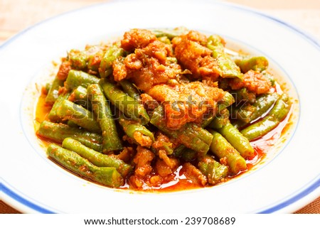 stir-fried pork spicy with lentils with herbs and spices as an ingredient, thai food. - stock photo