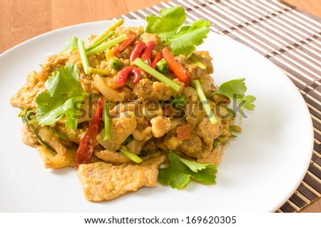 Stir fried pork spicy yellow curry with vegetable - stock photo