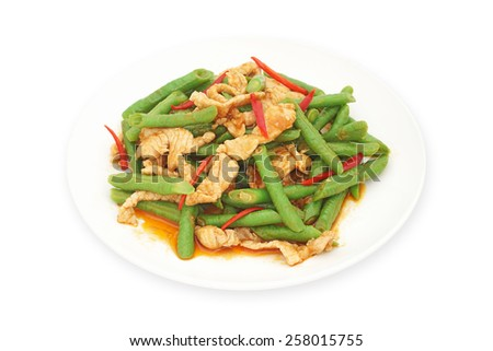 stir fried pork with yard long bean  and red curry on white plate