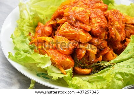 stir fried salmon in curry paste on plate