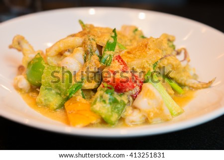 Stir-fried salted egg with squid on dish,  Thai food