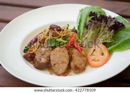 Stir fried spaghetti with Thai sausages Northern style, Spaghetti with Grilled Sausage, Spaghetti Asgaew, Sai Ua Moo thai language (pork sausage) - stock photo