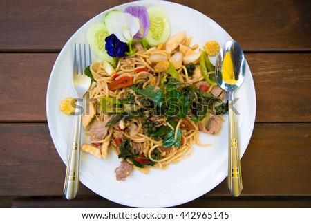 stir-fried spicy spaghetti . thai style stir-fried spicy spaghetti .  - stock photo